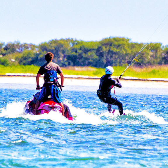 Florida Instructor teaching a Kiteboarding lesson in Clearwater Tampa Bay Area with jetski support