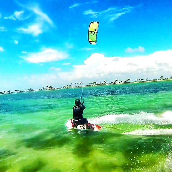 Kiteboarding crystal clear beautiful waters of tampa bay clearwater beach area with jetski supported kiteboarding lessons and instruction at florida action sports kite school